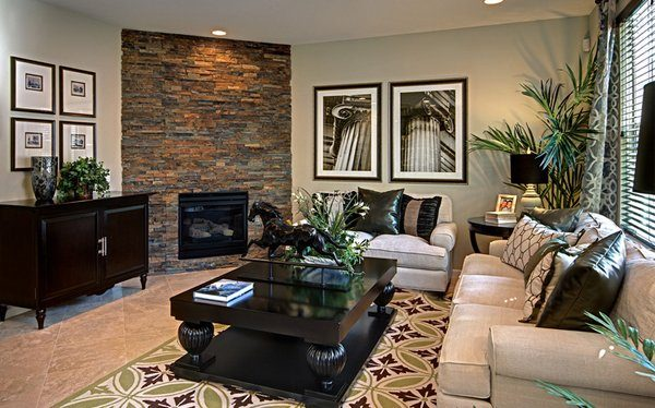 living room with fireplace in corner
